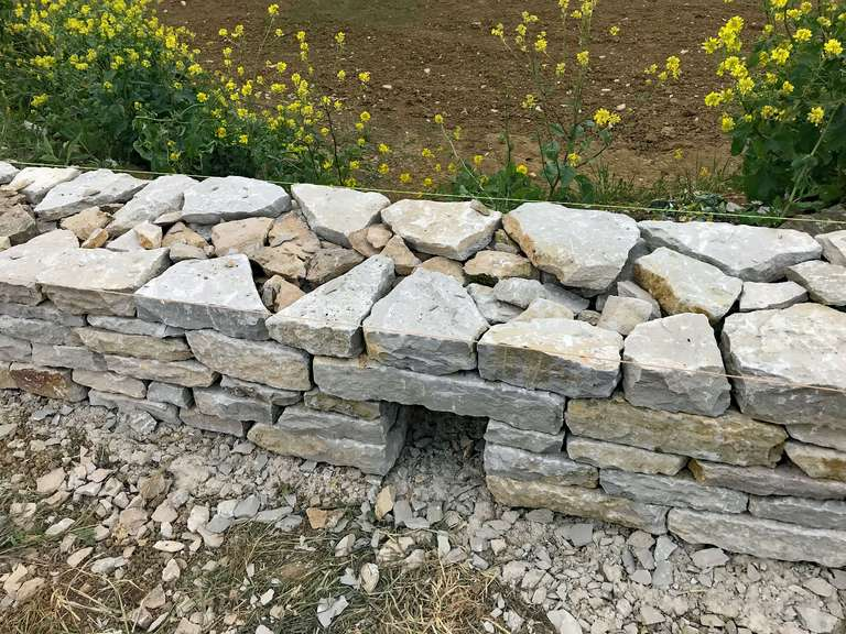 Drainage channel in new drystone wall